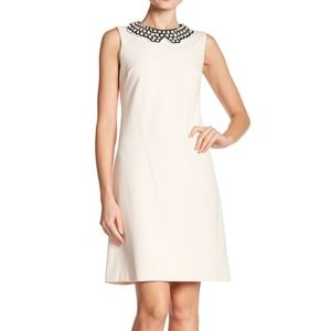 Scuba crepe dress with a knotted pearl collar